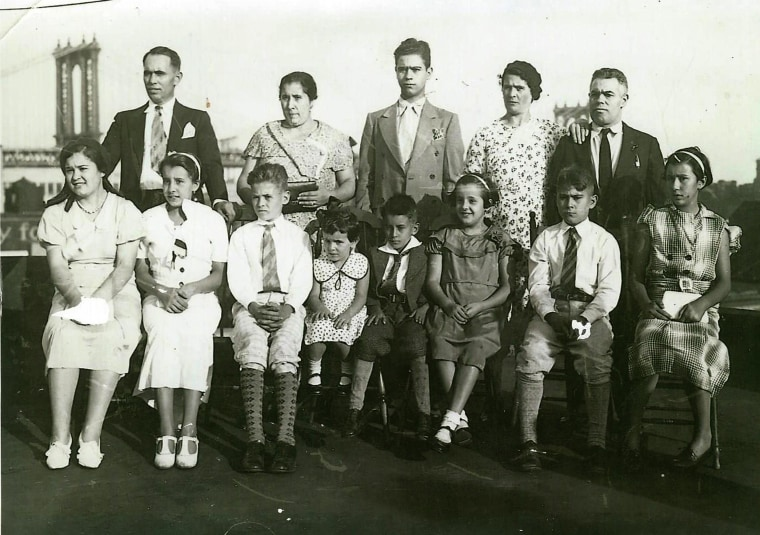 InvisibleImmigrants45.jpeg: Caption: The Rico family with another unidentified family in the Lower East Side, NYC.  Credit: Fernandez family/Invisible Immigrants