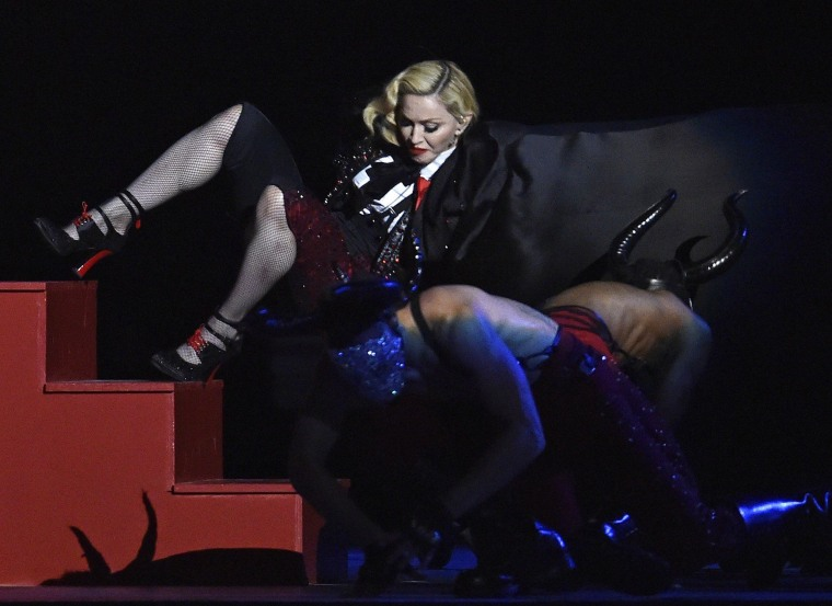 Image: Singer Madonna falls during her performance at the BRIT music awards at the O2 Arena in Greenwich, London