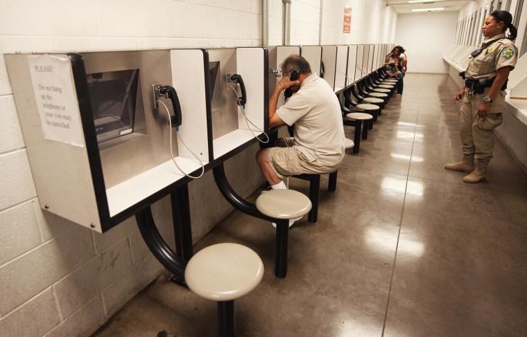 Detention Officer Rene Ansley(R) looks o