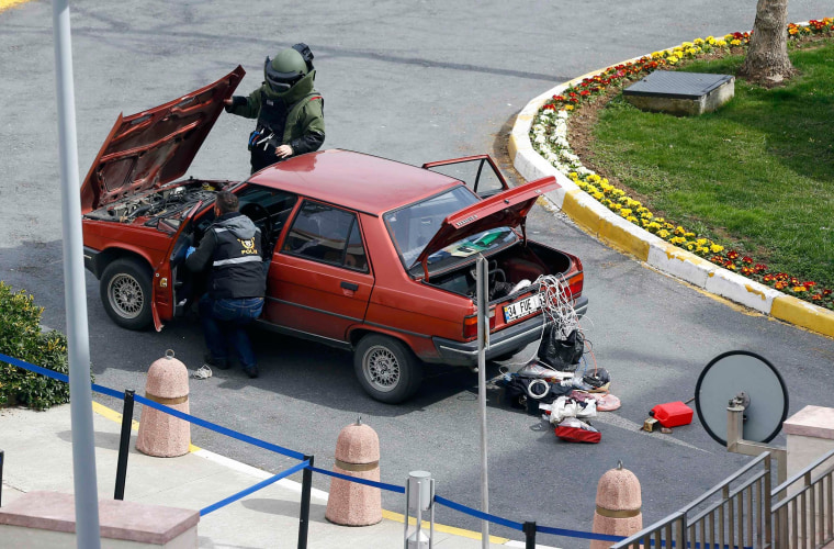 Image: Members of a bomb disposal unit check a vehicle near the U.S. Consulate in Istanbul