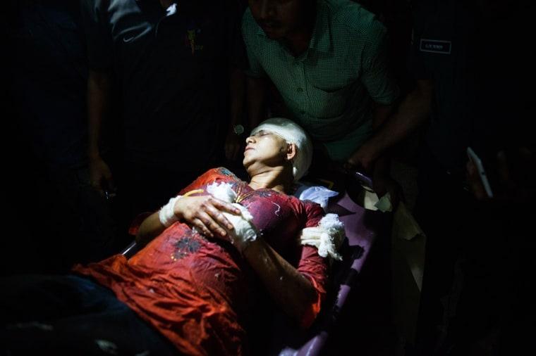 Image: Avijit Roy's wife Rafida Ahmed Banna is carried on a stretcher