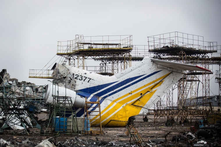 Destroyed commercial airplanes sit scattered on the runway of Donetsk Airport.