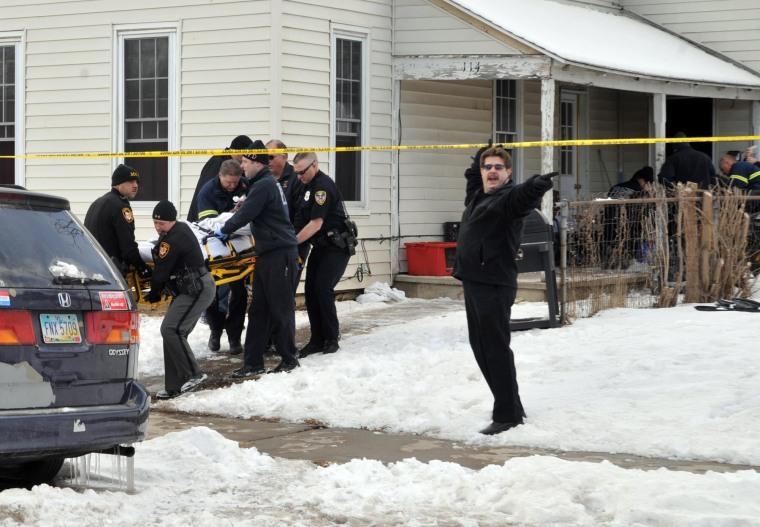Emergency personnel work to save four young victims of carbon monoxide poisoning in Troy, Ohio, on Feb. 27.