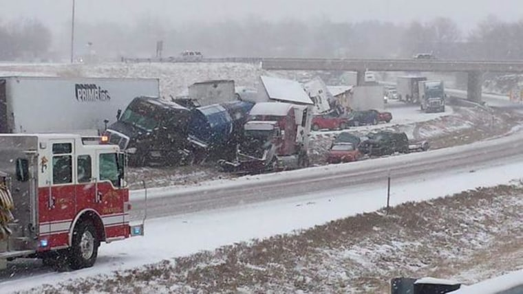 Tractor-trailers and cars are seen on Interstate 44 in Missouri after a chain-reaction crash near Rolla, Missouri, Saturday.