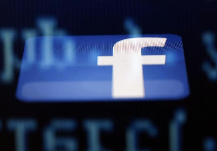 Image: File photo illustration of a Facebook logo