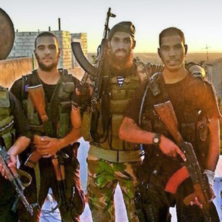 From left, Mohammed el-Araj, Yilmas a former soldier from Holland, and Choukri Ellekhlifi pose in Syria. El-Araj and Ellekhlifi were London associates of Jihadi John.