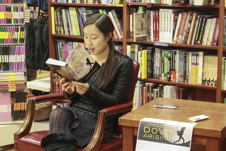 """Karen Bao reads her book, """"Dove Arising,"""" at an event at Book Culture, a book store near Columbia University in New York."""