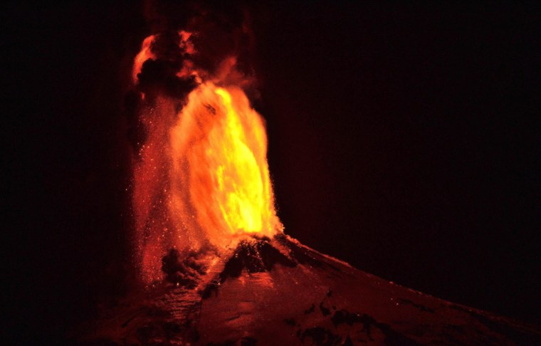 Image: Ash and lava spew from the Villarrica volcano, as seen from Pucon, Chile