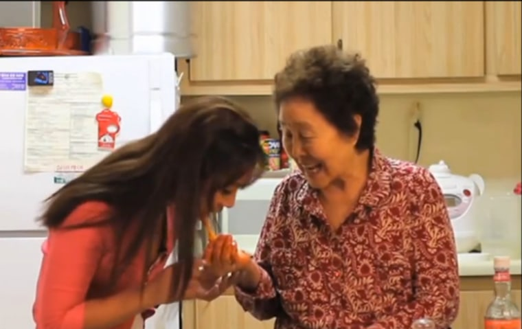 "Shin tastes her grandmother's cooking in the first episode of ""Cooking with Granny."""