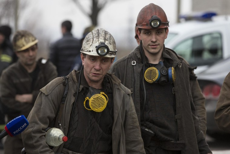 Image: Miners arrive to help with the rescue effort in Zasyadko coal mine in Donetsk