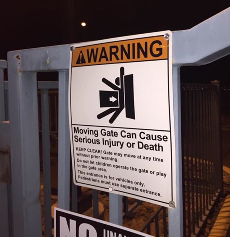 Warning sign on an automatic gate where a child was fatally injured.