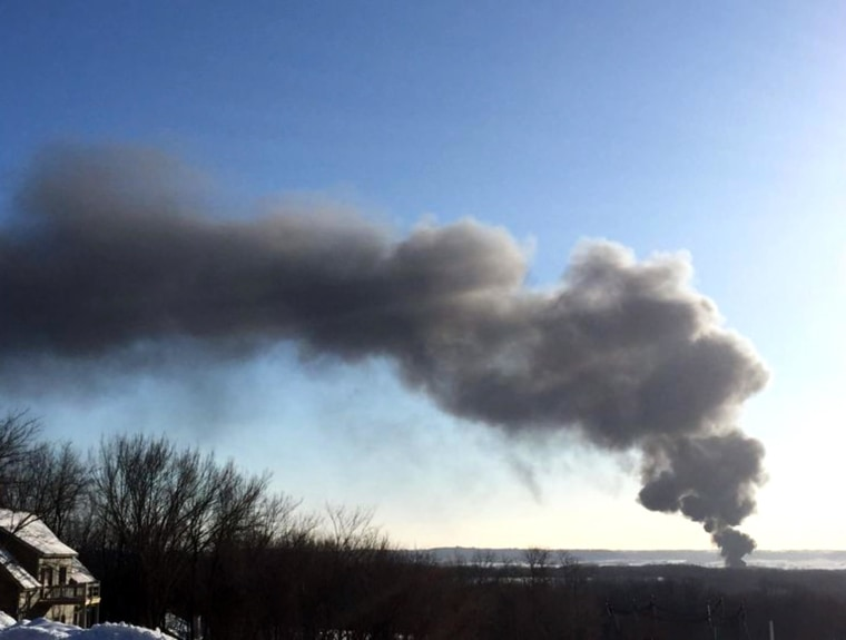 Smoke rises from the scene of a train derailment near Galena, Illinois, Thursday. The train was carrying crude oil, and at least two train cars caught fire, authorities said.