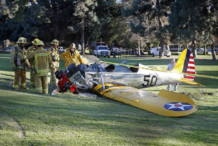 Image: An airplane sits on the ground after crash landing at Penmar Golf Course in Venice, Los Angeles CA