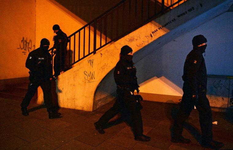 Police officers walk at an Islamic Cultural Centre that was searched in Bremen, Germany, 28 February 2015. Several people were arrested after German police issued a warning on 28 February that there was an imminent threat of a violent Islamist attack on the northern port city of Bremen. A federal authority has been receiving tip-offs since the previous evening about the activities of potential Islamist threats, the police said.