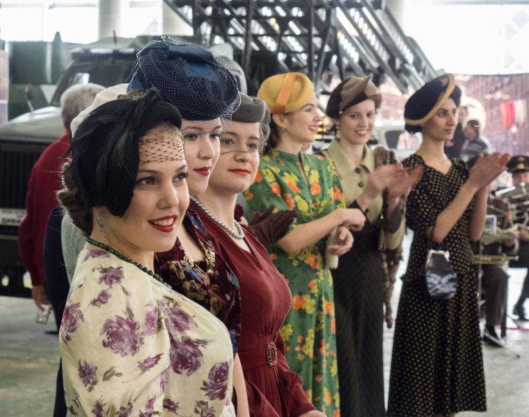 Image: Amateur models walking the catwalk in vintage WWII-era dresses