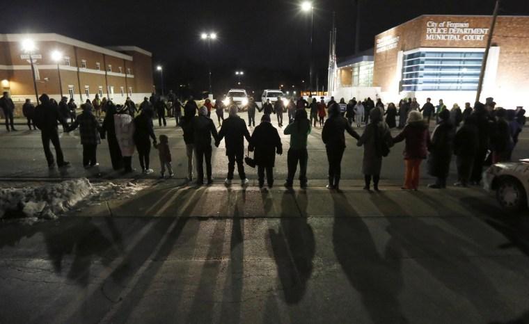 Image: Protestors block traffic outside the Ferguson