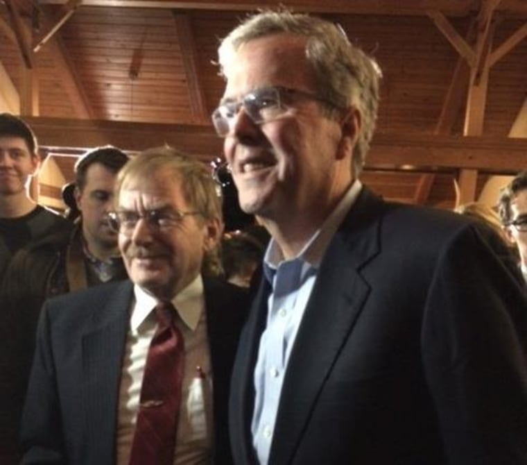 Jeb Bush taking picture with attendee at a fundraiser for Rep. David Young, R-Iowa, in Urbandale, Iowa on March 6, 2015