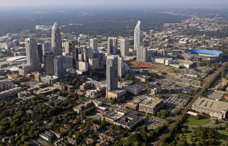 FILE - The skyline of downtown Charlotte, N.C., is shown in this Aug. 16, 2012 file photo. The U.S. Census Bureau announced on Thursday, March 27, 2014 that North Carolina's population is approaching 9.9 million people and that the state has five of the nation's 100 fastest-growing counties.  (AP Photo/Chuck Burton, file)