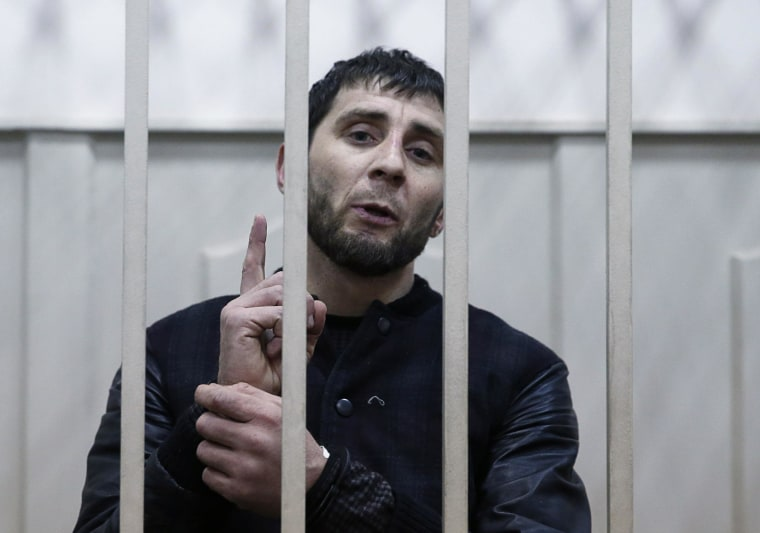 Image: Zaur Dadayev, charged with involvement in the murder of Russian opposition figure Boris Nemtsov, speaks inside a defendants' cage in Moscow