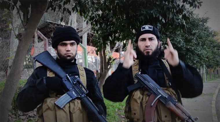 A member of ISIS uses sign language in a recruitment video for the group.