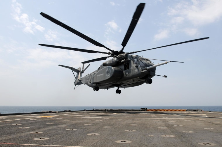 An MH-53E Sea Dragon helicopter prepares to land on the flight deck aboard the Afloat Forward Staging Base (Interim) USS Ponce in 2012.