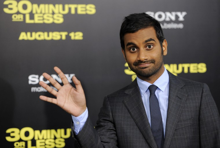 "Aziz Ansari, a cast member in ""30 Minutes or Less,"" waves to photographers at the premiere of the film in Los Angeles, Monday, Aug. 8, 2011."