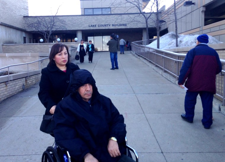 Angel Gonzalez Sr. is wheeled from the Lake County Courthouse where his son was exonerated Monday of a conviction in a 1994 abduction and rape for which he served 20 years of a 40-year sentence.
