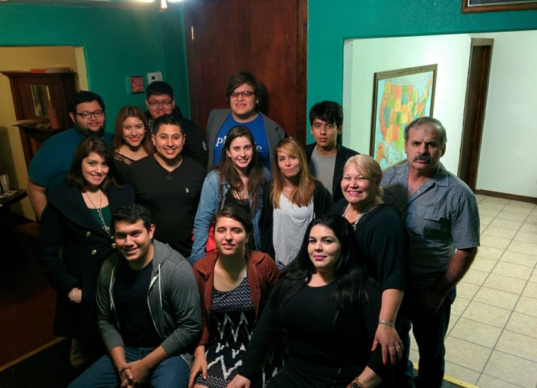 """In the front row: Sarah Marie Chavez (center), Patricia Estrada (right), founders of Sand2Pearl, the non-profit who started the """"Dream Home"""" initiative. Also in the picture are Estrada's parents, as well as community members and students."""