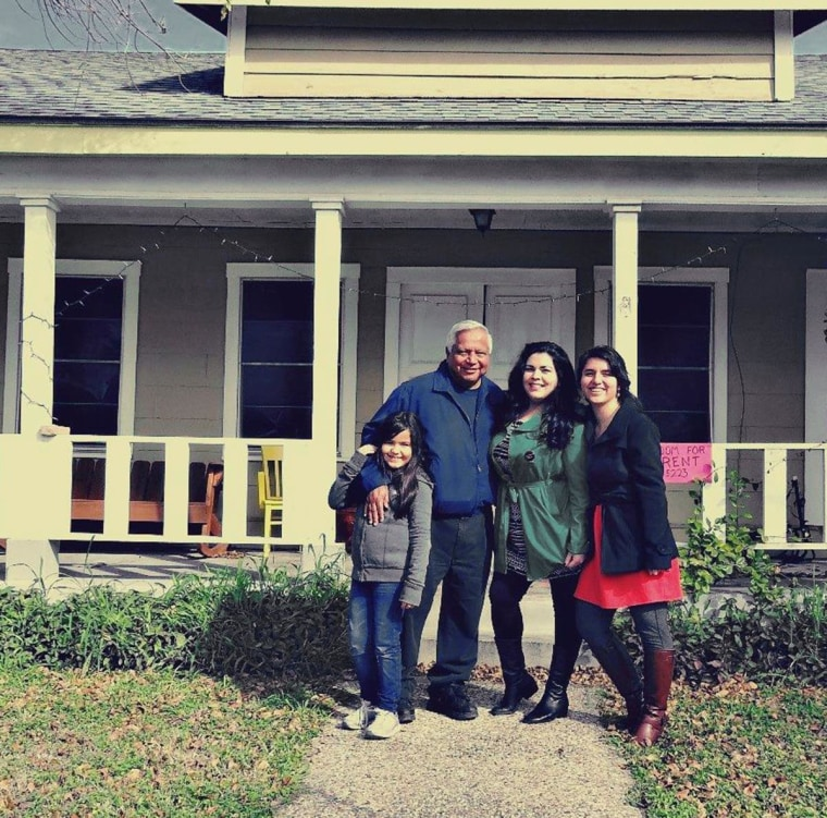 """Left to right: Arnold Rodriguez, Patricia Estrada and Sarah Marie Chavez, in front of the first """"Dream Home,"""" which will house DREAMers starting in August."""