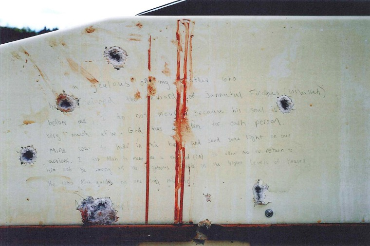 Bullet holes and blood surround a note thought to be written by Dzhokhar Tsarnaev in the boat where he was apprehended in Watertown, Mass. The government released transcripts and stills of the note on March 10.