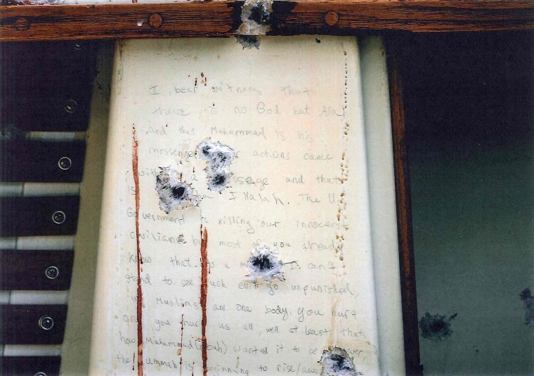 Bullet holes and blood surround a note thought to be written by Dzhokhar Tsarnaev in the boat where he was apprehended in Watertown, Mass. The government released transcripts and stills of the note on March 10, 2015.