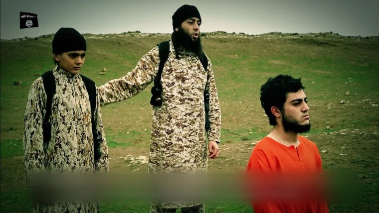 A still from a video purports to show the killing of ISIS hostage Muhammed Musallam, right. ISIS accused Musallam - an Isareli Arab - of being a spy for Mossad.