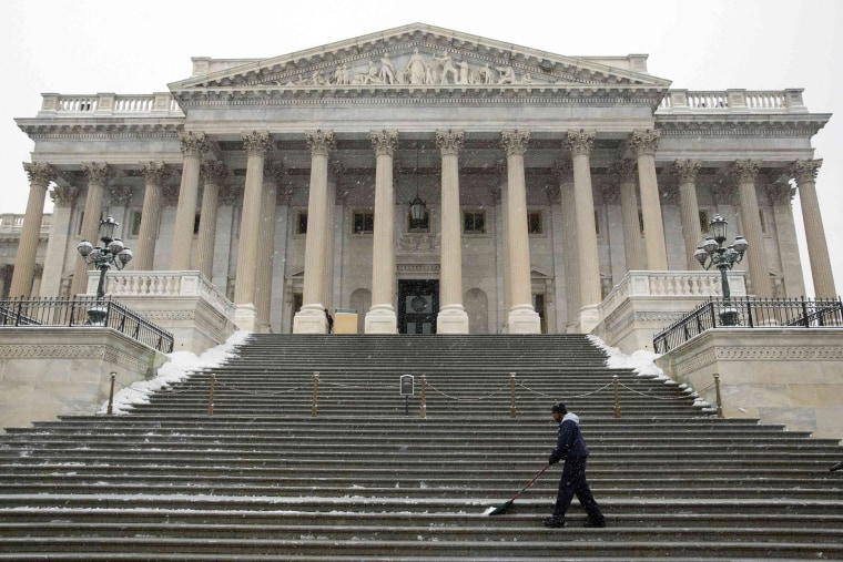 Image: An Architect of the Capitol staff clears snow from the steps of the Senate Chamber at the U.S. Capitol in Washington