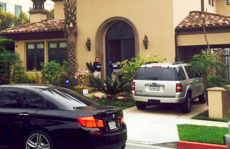 ICE agents search a house in Beverly Hills, California on March 11, 2015.