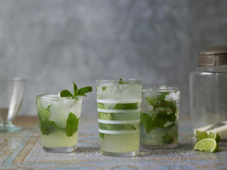 """A picture of mojitos from """"The Cuban Table: A Celebration of Food, Flavors, And History"""" By Ana Sofia Pelaez (author) and Ellen Silverman (photographer)"""