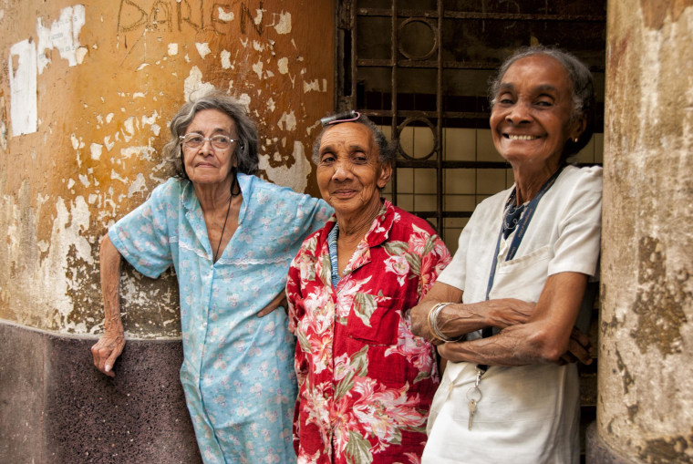 These three Cuban women show a few of the many variations in skin color that defy the binary definitions common in the United States.  Race is expressed in many ways, not simply as white or black.
