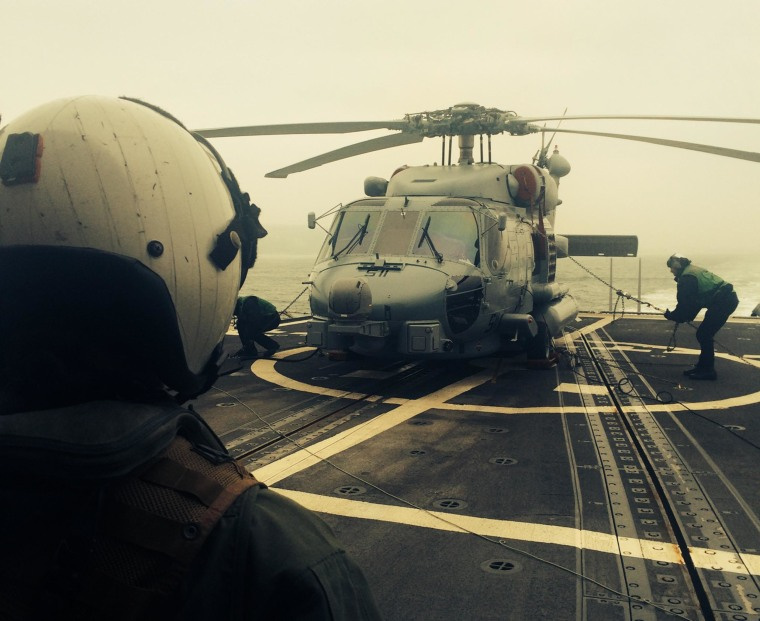 Image: Lt. Jessica Phenning looks at MH-60R Seahawk helicopter on March 10