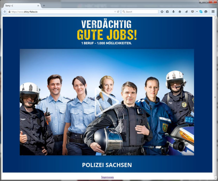 Image: Visitors of the Shinky Flakes website are now greeted by a photo of smiling police officers.
