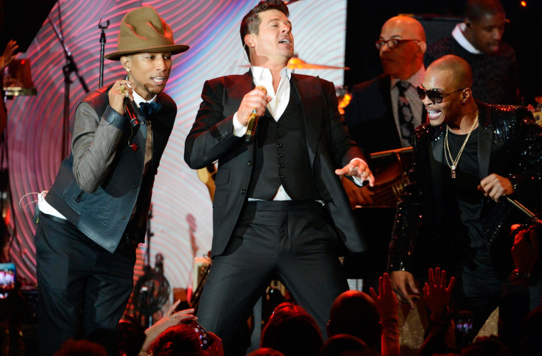 Image: File photo of Pharrell Williams, Robin Thicke and T.I. performing at the Clive Davis Pre-Grammy Gala and Salute to Industry Icons, honoring Universal Music Group Chairman and CEO Lucian Grainge, in Beverly Hills