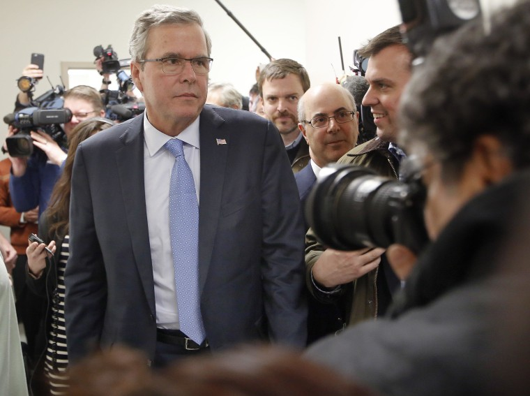Former Florida Gov. Jeb Bush walks through the crowded halls during a stop at Integra Biosciences Friday, March 13, 2015, in Hudson, N.H. (AP Photo/Jim Cole)