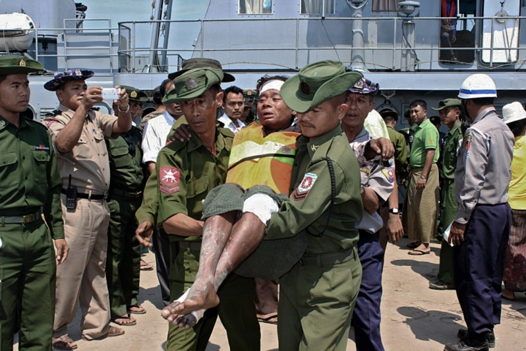 Image: A survivor from an overloaded ferry that sank is carried