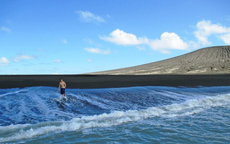 Zandy Sugar steps walks on the shore of a new island created by a volcanic eruption earlier this year. Charter boat owner Branko Sugar told NBC via email that the new land deserved a name and suggested Zandy, after his son, the first person to touch the black volcanic soil.
