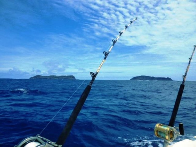 A photo by charter boat owner Branco Sugar shows the space between two islands before a volcanic eruption created a third island.