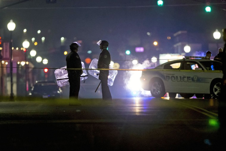 Image: Outside the police station in Ferguson, Mo., where two officers were shot.