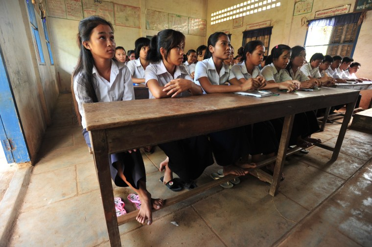 Girls study at a school in Cambodia.