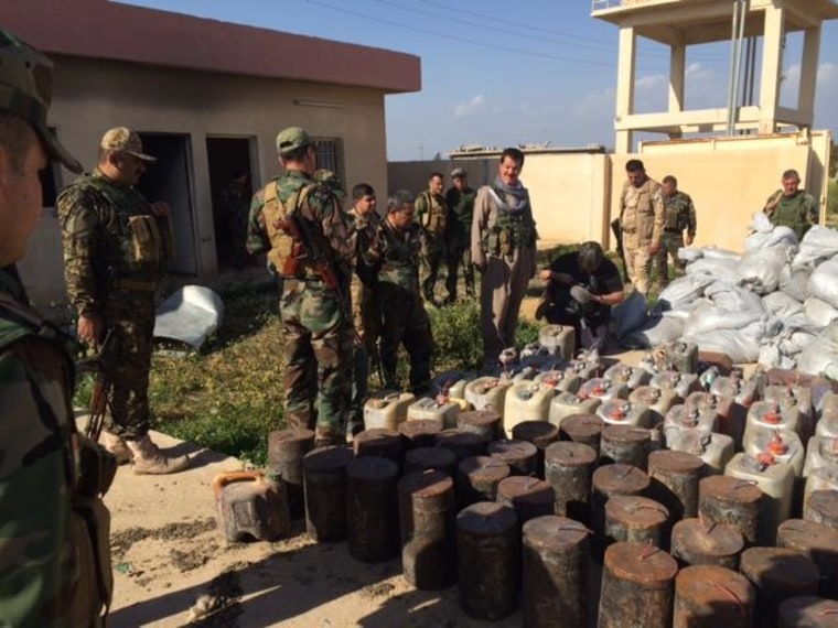 Kurdish Peshmerga fighters show off IEDs found in recovered territory taken back from ISIS fighters near Kirkuk.