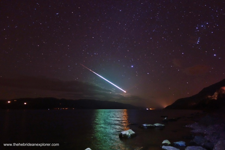 A meteor streaks through the sky above Loch Ness in Scotland on Sunday, March 15, 2015.