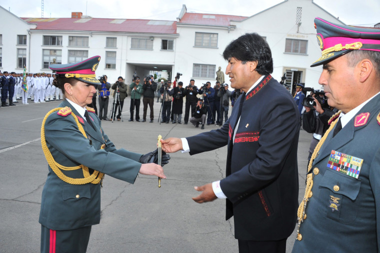 Image: Bolivia's President Evo Morales gives a military baton to newly promoted General Gina Reque Teran during a ceremony in the military headquarters in La Paz