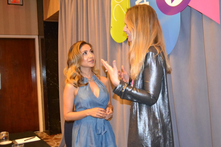 Dulce Candy, recipient of the Latinovator award, speaks to blogging mentor Nikki Novo, after her press conference at the 2015 Hispanicize event (#Hispz15).