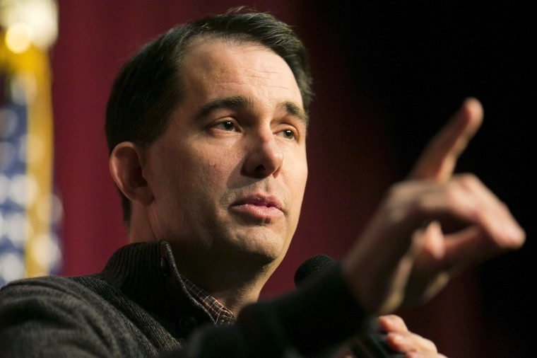 Image: Governor Scott Walker speaks at a Republican organizing meeting in Concord